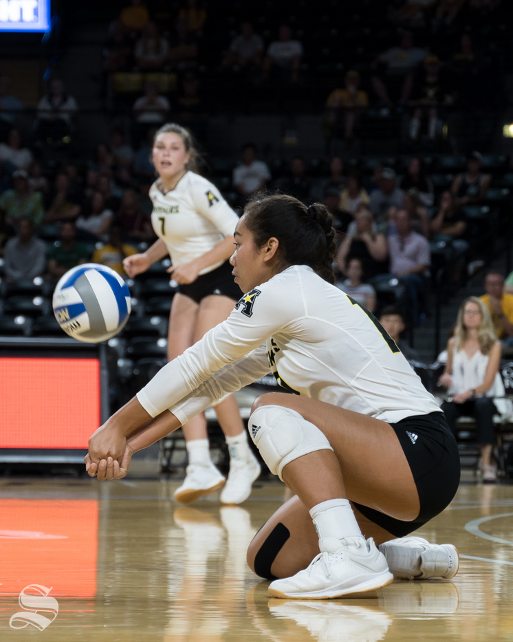 Wichita State freshman Sina Uluave digs the ball during the game against Texas on September 14, 2019 at Koch Arena.
