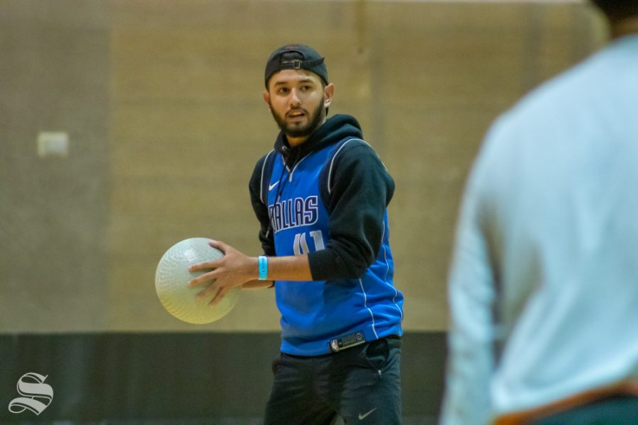 Trey from the team of Phi Delta Theta throws the first ball for his team.