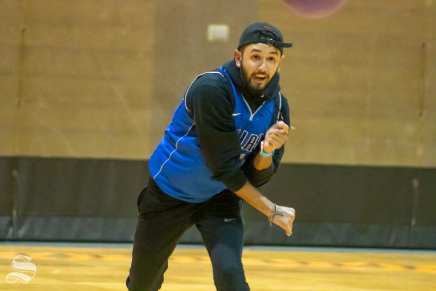 Trey from the team of Phi Delta throws the first ball for his team during the Dodgeball Tournament on Wednesday, Oct. 23.