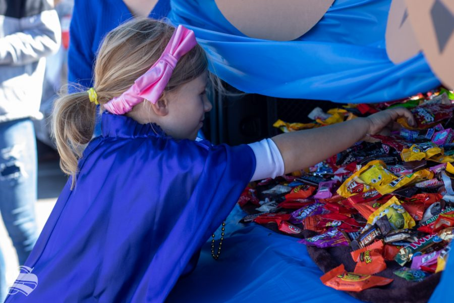A Cookie Monster themed trunk ensures that children reach into the mouth of the cookie monster to grab candy during the Trunk or Treat event on Saturday, Oct. 19 at Braeburn Square.