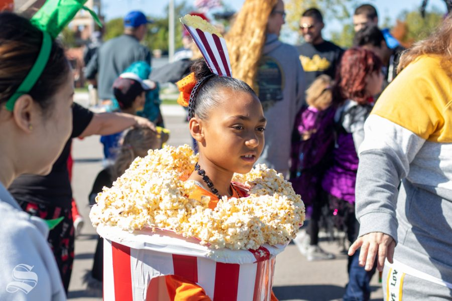 A child present for the Trunk or Treat event on Saturday, Oct. 19 walks from trunk to trunk dressed as a popcorn bucket in Braeburn Square.