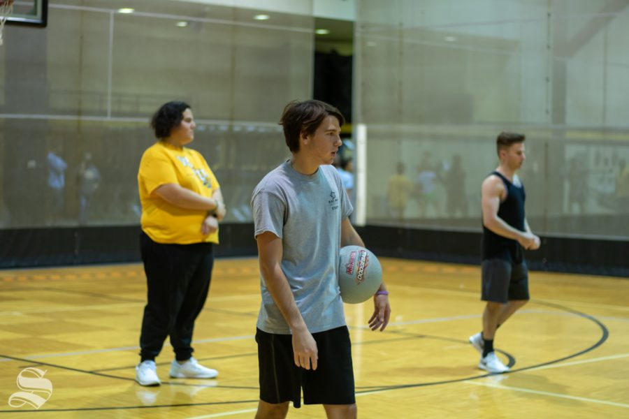 The men of Sigma Alpha Epsilon advance upon the opposing team during the Dodgeball Tournament on Wednesday, Oct. 23 at the Heskett Center Gym.