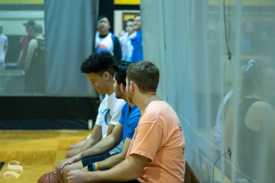 Members of Sigma Phi Epsilon talk strategy while sitting on a bench during the dodge ball tournament hosted by Student Activities Council on Wednesday, Oct. 23.