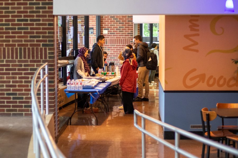 Students check the food options at one of the Interfest event tables on Oct. 3 at Hubbard Hall. The event was moved to Hubbard Hall from the Multicultural Greek Council Quad due to weather.