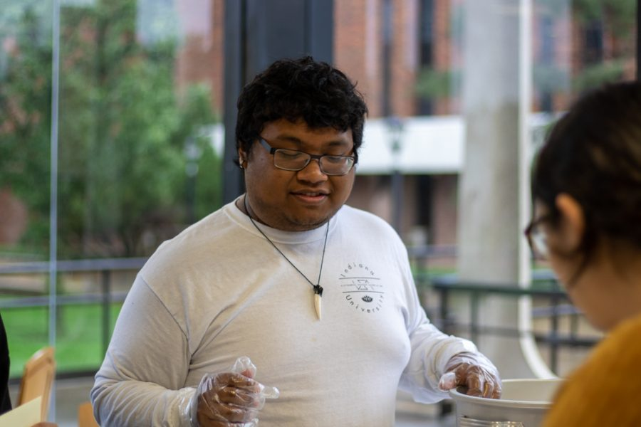 Wichita State student Richy Thach serves a Traditional southern Indian breakfast. Some of the dishes included dosa, sambar vada, and khara kadubu.