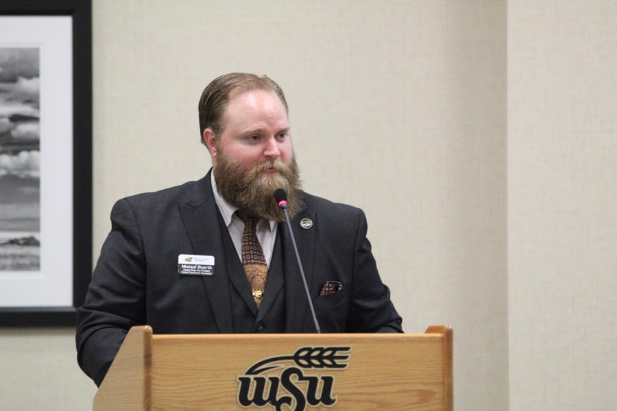 Student Body Vice President Michael Bearth speaks at last Wednesday's Student Government Association meeting. He and the rest of SGA hope to fill the end-of-the-year Student Fees Committee early this year.