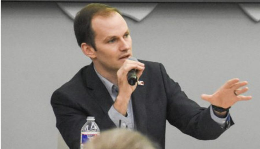 Kansas Rep. Brandon Whipple answers a question at a student-led forum.