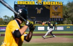 Senior Preston Snavely steps to throw a pitch to one of the yellow team players during game 5 of the Black and Yellow Fall World Series on Saturday, Oct. 19 at Eck Stadium.