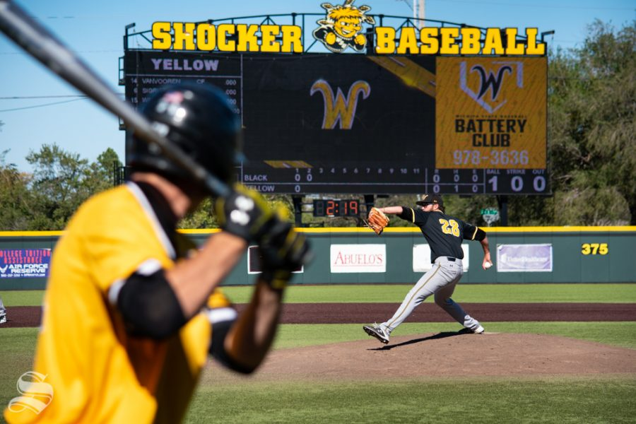 Senior+Preston+Snavely+steps+to+throw+a+pitch+to+one+of+the+yellow+team+players+during+game+5+of+the+Black+and+Yellow+Fall+World+Series+on+Saturday%2C+Oct.+19+at+Eck+Stadium.