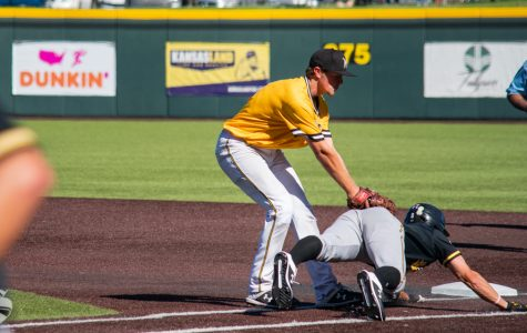 Freshman Blake Marsh tags senior Jacob Katzfey out as he approaches first during game 5 of the Black and Yellow Fall World Series on Saturday, Oct. 19 at Eck Stadium.