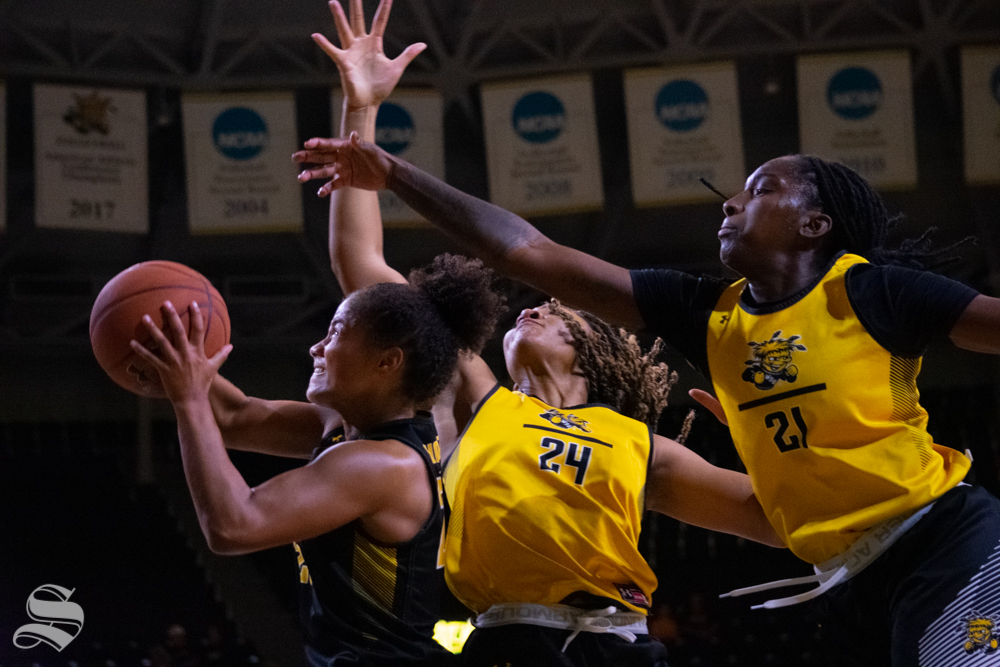Sophomore Seraphine Bastin jumps for the basket trailed by sophomore Trajata Colbert and senior Maya Brewer during the Black and Yellow Scrimmage on Oct. 5 at Koch Arena.