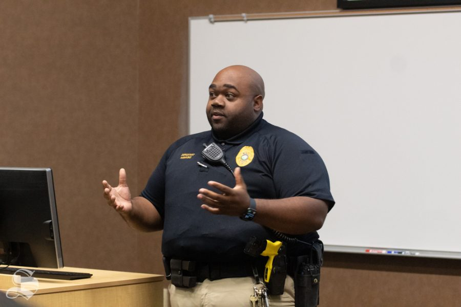 Sgt. Kevin Hawkins of the Wichita State University Police Department speaks Wednesday at the Black Student Union's biweekly meeting. He was one of three local black officers to speak about community policing, rights and how to interact with officers.
