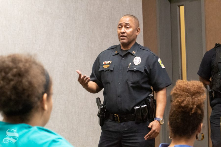 Capt. Wendell Nicholson of the Wichita Police Department speaks Wednesday at the Black Student Union's biweekly meeting. He was one of three local black officers to speak about community policing, rights and how to interact with officers.