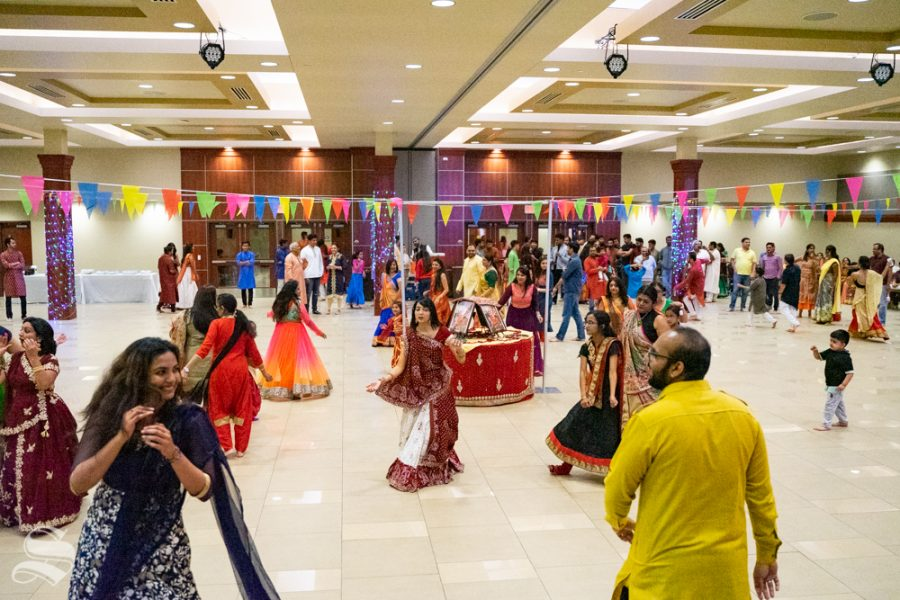 Patrons+dance+together+during+Garba+Night+on+Oct.+5+in+the+Rhatigan+Student+Center.