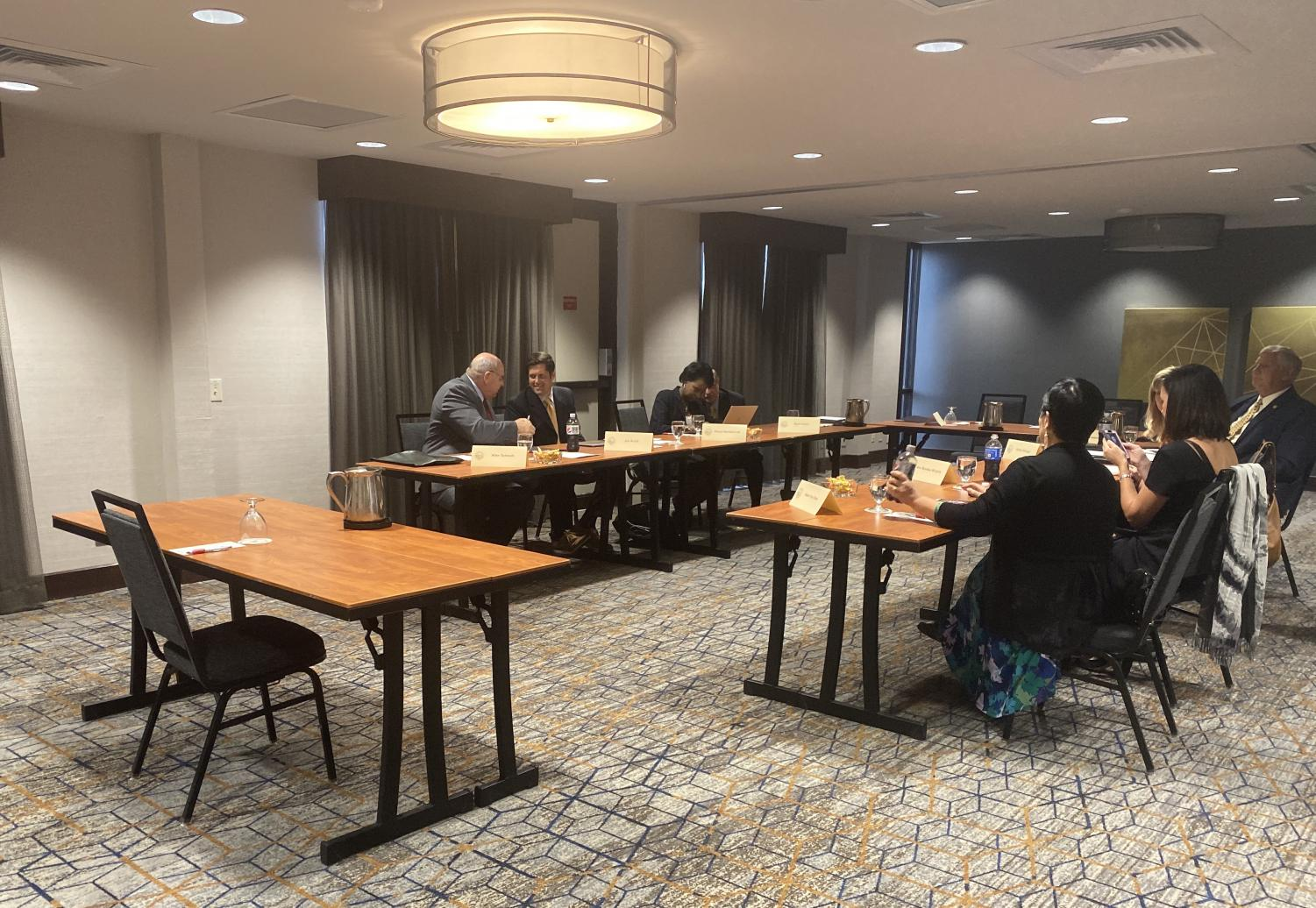 Members of the Kansas Board of Regents congregate before they interview finalists for the next Wichita State president. The interviews are being held at a Marriott Hotel at the Kansas City Airport.