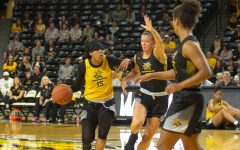 Wichita State sophomore Jaida Hampton dribbles the ball during the Black and Yellow Scrimmage on Saturday inside Charles Koch Arena.