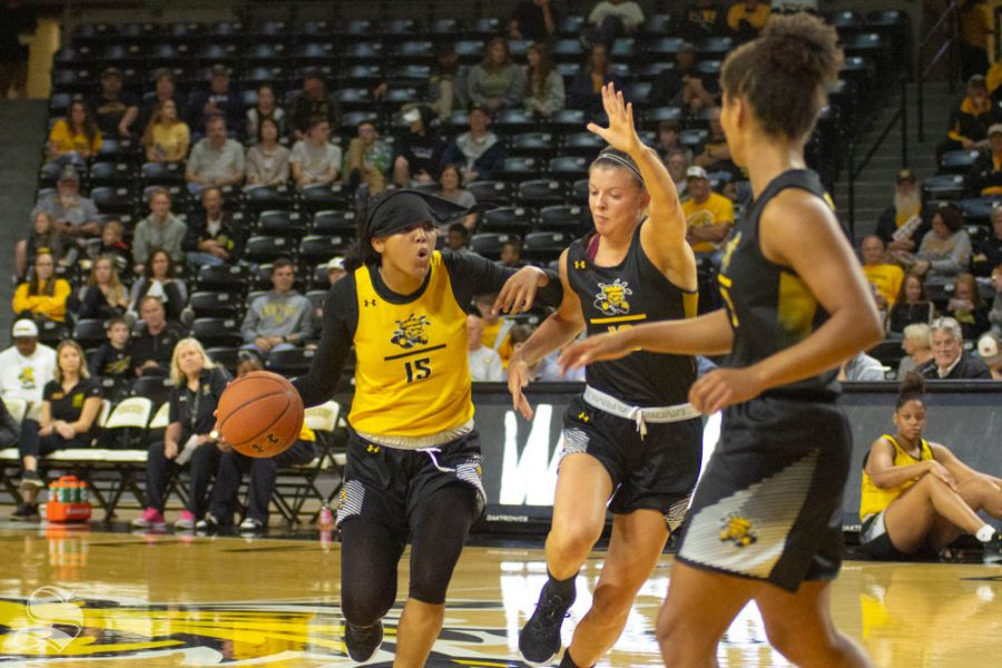 Wichita+State+sophomore+Jaida+Hampton+dribbles+the+ball+during+the+Black+and+Yellow+Scrimmage+on+Saturday+inside+Charles+Koch+Arena.