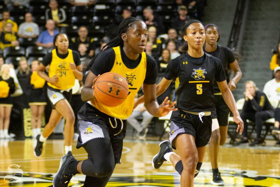 Wichita State senior Maya Brewer drives on a fastbreak during the Black and Yellow Scrimmage on Saturday inside Charles Koch Arena.