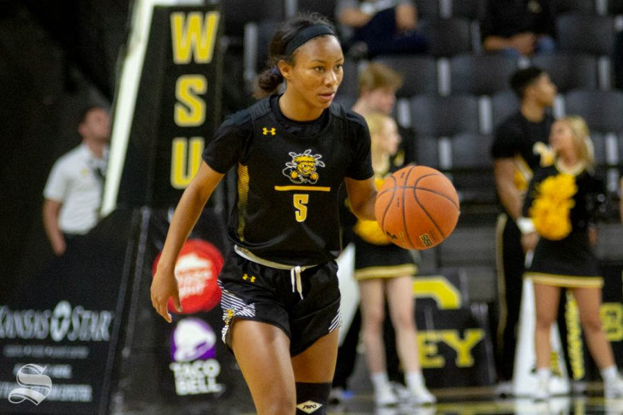 Wichita State senior Ashley Reid brings the ball up the floor during the Black and Yellow Scrimmage on Saturday inside Charles Koch Arena.
