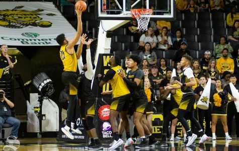 Wichita State senior Jaime Echenique goes up for a hook shot during the Black and Yellow Scrimmage on Saturday inside Charles Koch Arena.