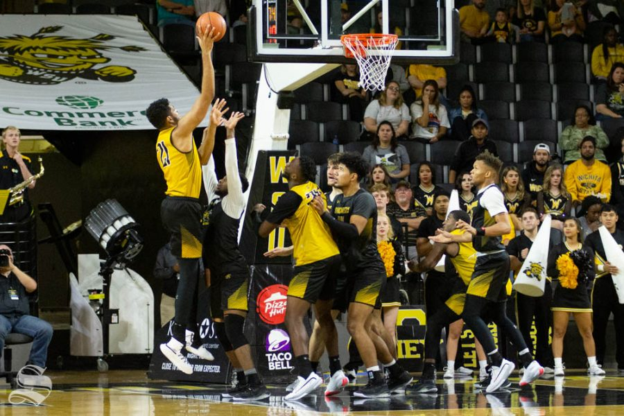 Wichita+State+senior+Jaime+Echenique+goes+up+for+a+hook+shot+during+the+Black+and+Yellow+Scrimmage+on+Saturday+inside+Charles+Koch+Arena.