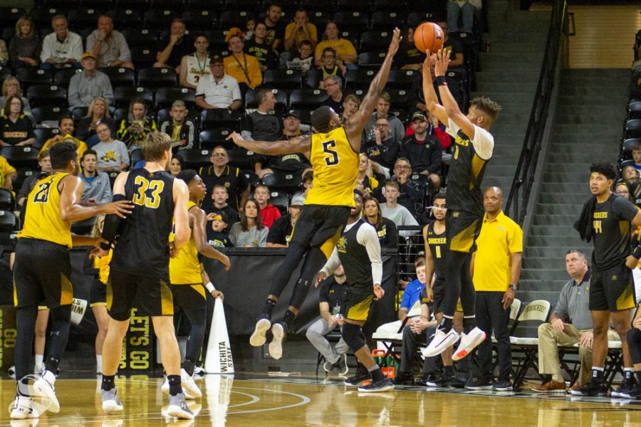 Wichita+State+sophomore+Dexter+Dennis+attempts+a+three-pointer+before+the+final+buzzer+over+junior+Trey+Wade+on+Saturday+during+the+Black+and+Yellow+Scrimmage+inside+Charles+Koch+Arena.+Wade+ended+up+blocking+the+shot%2C+securing+a+win+for+the+Yellow+Team.