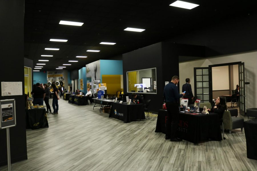 Event goers walk through the lobby of WSU South during Fridays ICTechXpo was filled with local tech-based businesses, as well as some college recruiters.