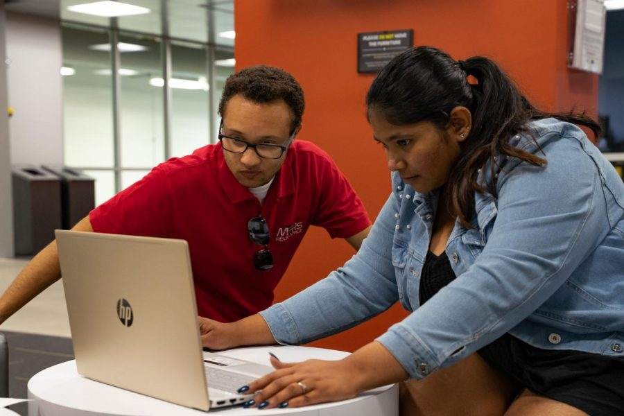 Lucas Webb and Meghana Ravi work on their Rocket Designs for the NASA Student Rocket Launch Competition at the John Bardo Center on Wednesday, Oct 23.