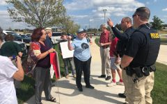 Protesters argue with officers about if they have to move from in front of the Law Enforcement Training Center ahead of Attorney General Bill Barr's October visit. Protesters were ultimately allowed to stay.