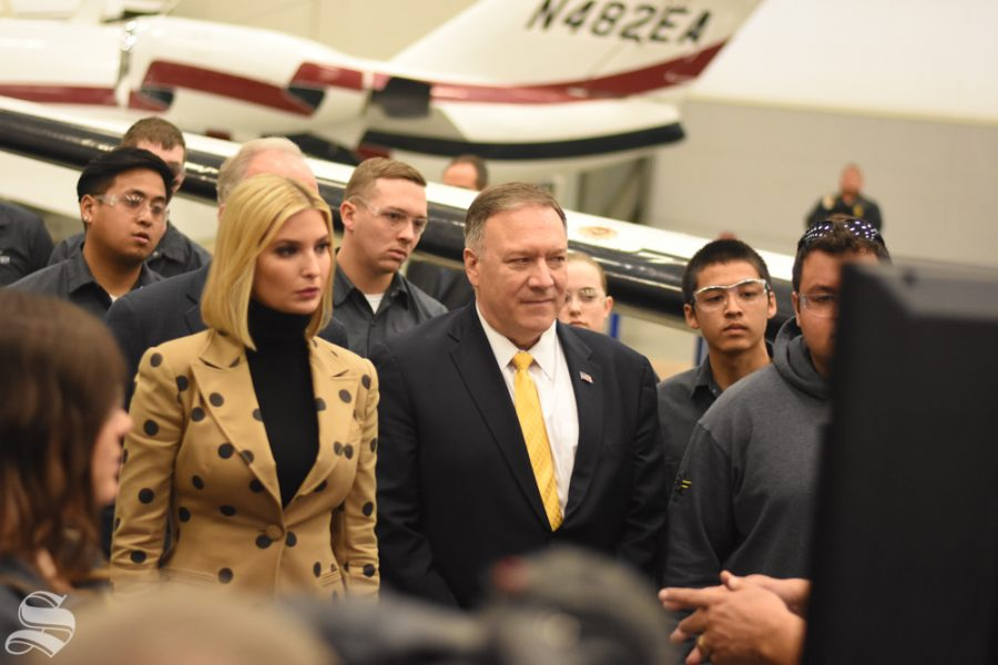 Mike+Pompeo+and+Ivanka+Trump+stand+with+WSU+aviation+students+during+a+tour+of+WSU+Tech+on+Oct.+24.