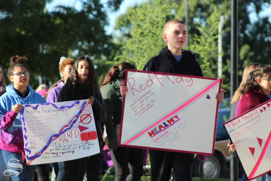 Students from The Coleman Middle School WorldChangers volunteer to lead the march through Wichita State's campus as part of the Purple Mile. This was the 5th year that it took place on WSU's campus and it's grown every year, organizers said.
