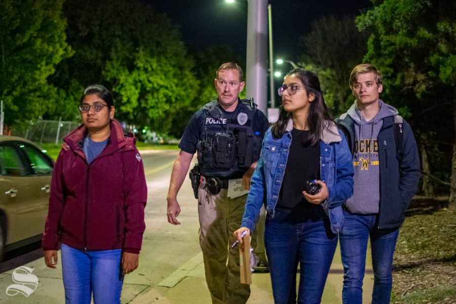 A group of students participate in the Safety Walk with Officer Wyatt Pulver on Oct. 8 at the Food Truck Plaza on Wichita State's main campus. The group was given a section of Wichita State's main campus to walk and discuss safety concerns which may require improvement.