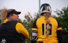 Wichita State's Head Coach Kristi Bredbenner speaks to junior Bailee Nickerson at third during their game against Kansas Univeriverity on Friday, Oct. 11 at Wilkin's Stadium.