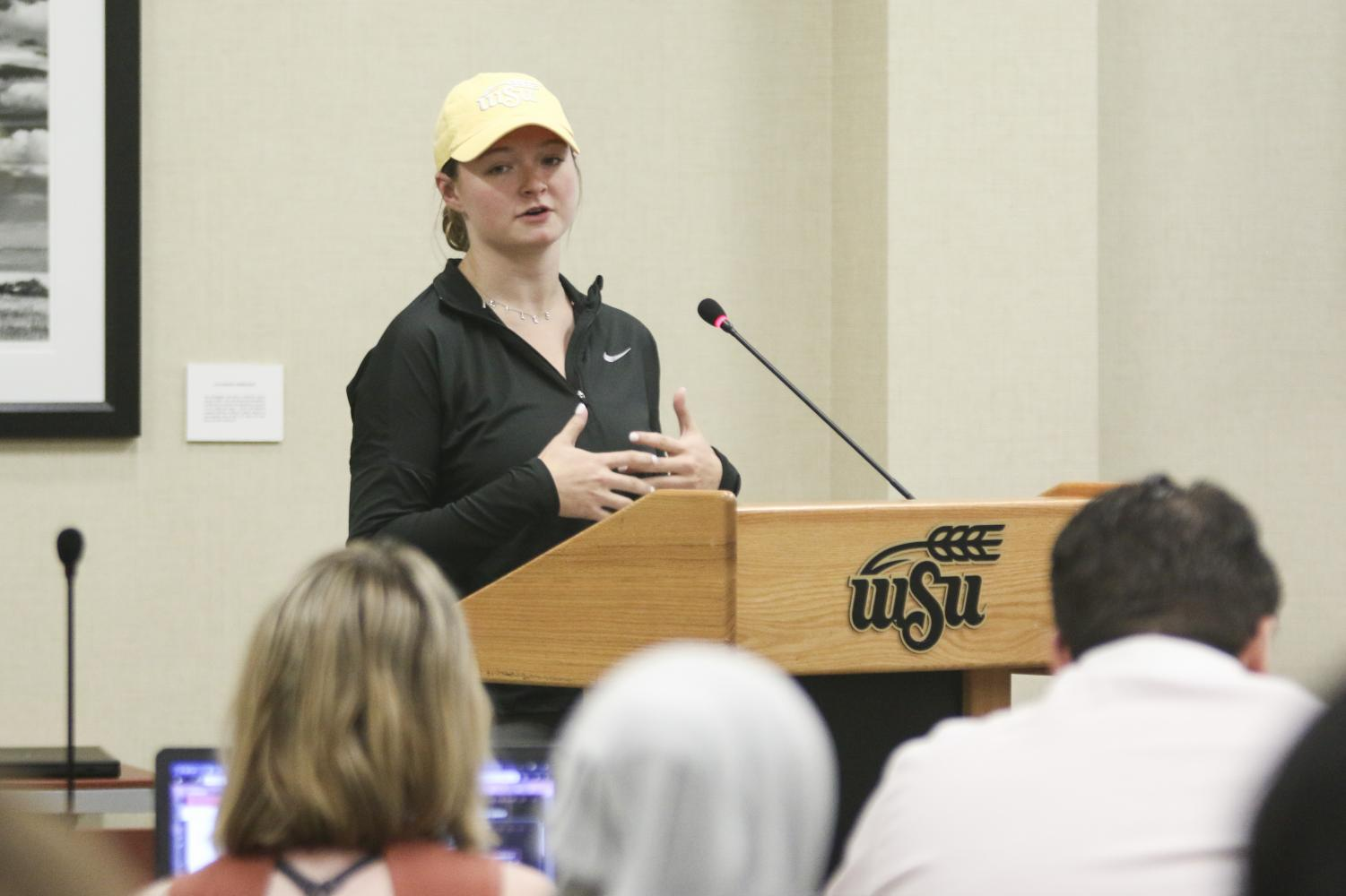 Kylee Sorrells, a marketing and game day operations assistant, speaks about changing the branding for the student section this year during public forum at SGA on Wednesday, Oct. 2, 2019.