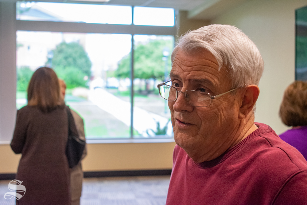 Mike Sperlazza speaks with a writer from The Sunflower during his retirement celebration on Oct. 4 in the Rhatigan Student Center. Sperlazza was the manager of Postal Services and worked in Postal Services for 22 years.