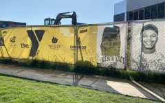 YMCA banners come down after face was cut out