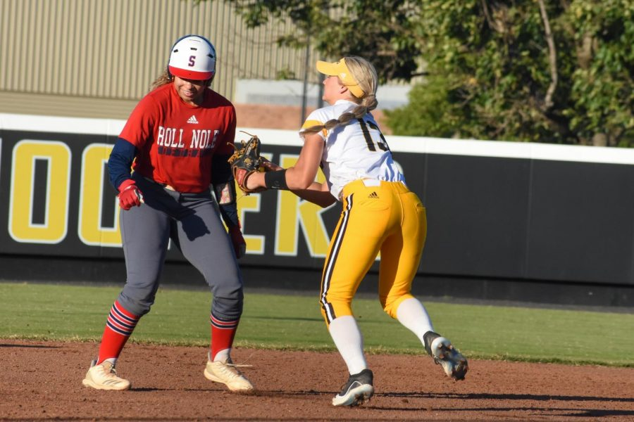 Senior Ryleigh Buck tags out a Seminole State runner during their game Tuesday at Wilkins Stadium.
