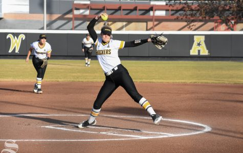 Junior Erin McDonald winds up for a pitch during the game against Cowley Community College on Monday.