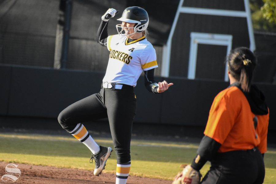 Wichita State senior Bailey Lange celebrates after scoring a double during the third inning of the game against Cowley Community College. The Shockers won 21-1.
