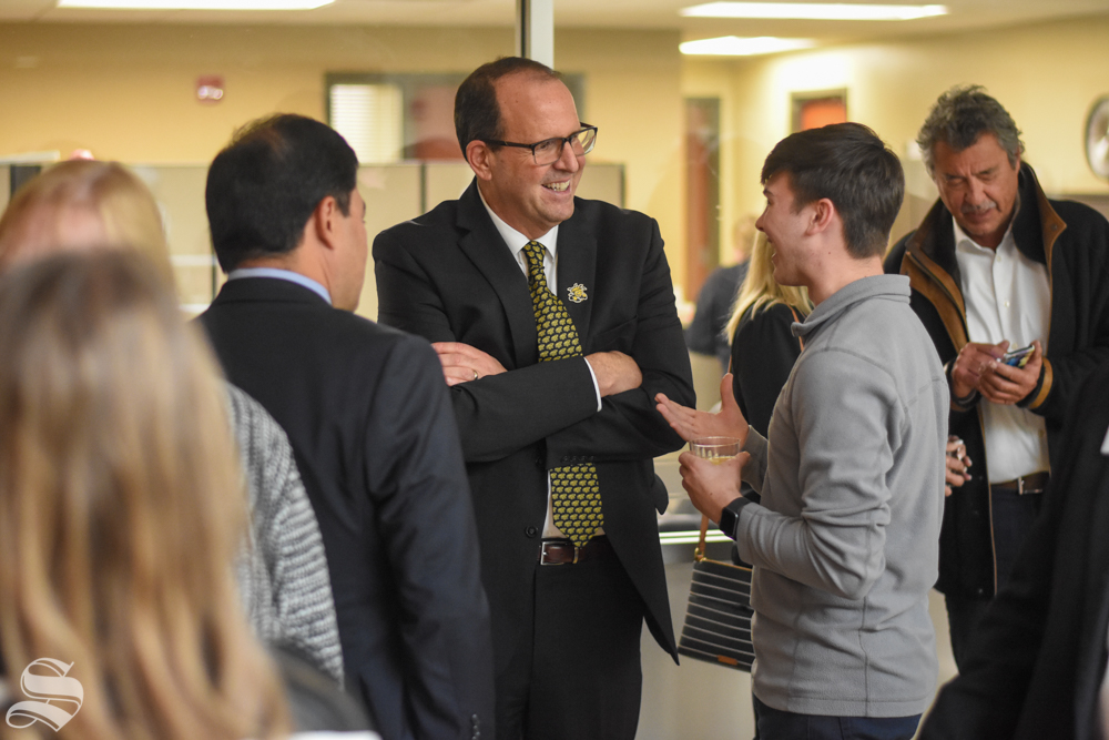 New President Jay Golden speaks to sophomore Drue Owen, a student studying history at WSU, after his public address on Thursday, Oct. 31 in the RSC.
