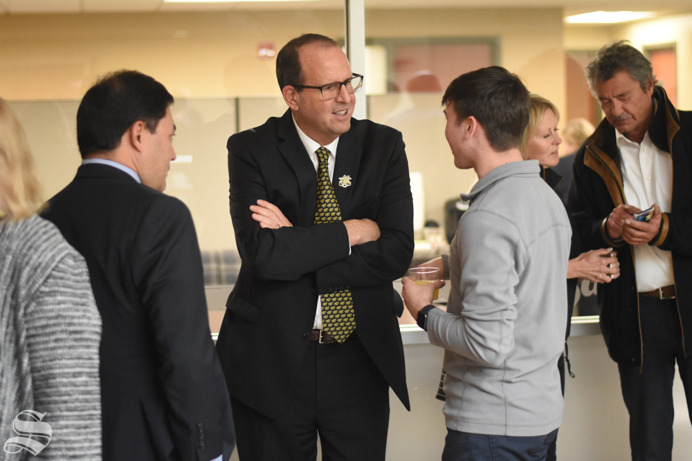 New President Jay Golden speaks to sophomore Drue Owen after his public address on Thursday, Oct. 31 in the RSC.