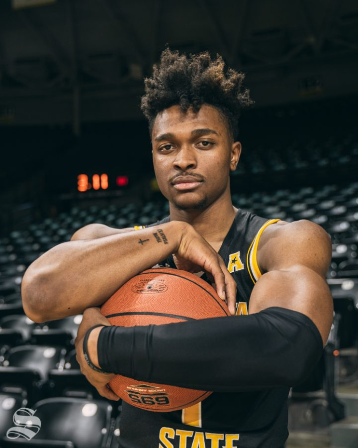 Freshman guard Tyson Etienne poses for a picture during media day Oct. 15 inside Charles Koch Arena.