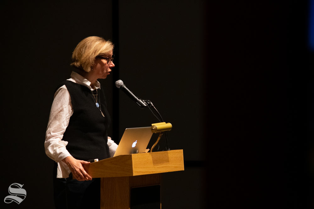Catherine Morris, the senior curator for the Sackler Center for Feminist Art, speaks to a crowd about a collection of art and the feminist perspective as it pertains to the pieces during the Tuesday, Nov. 5