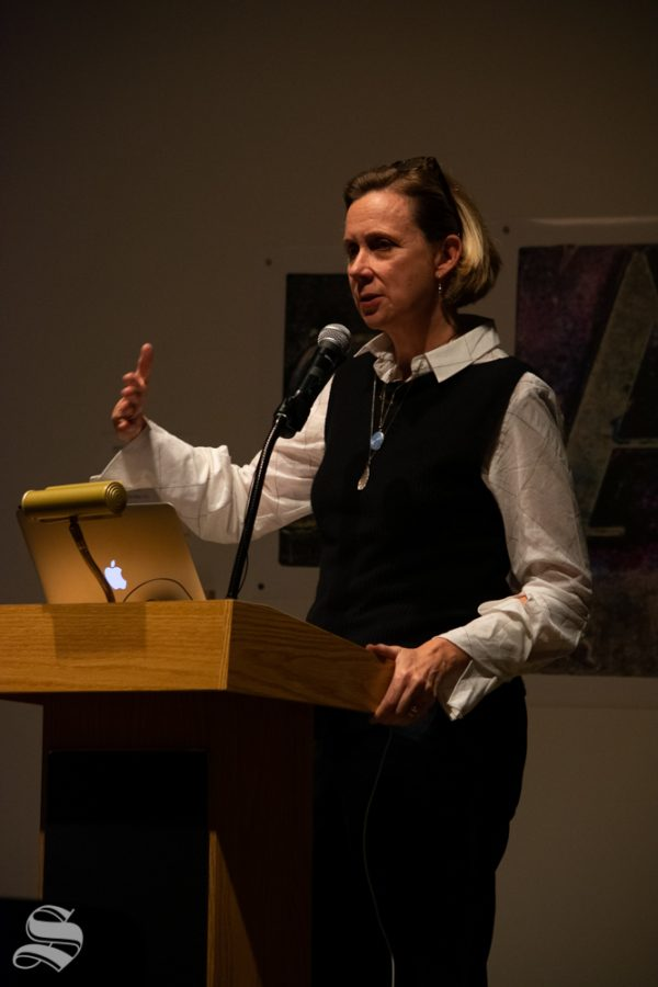 Catherine Morris, the senior curator for at the Sackler Center for Feminist Art, speaks to a crowd about a collection of art and the feminist perspective as it pertains to the pieces during the Tuesday, Nov. 5 Voices from the Vault / Curatoring in the Key of F Minor event at the Ulrich Museum of Art.