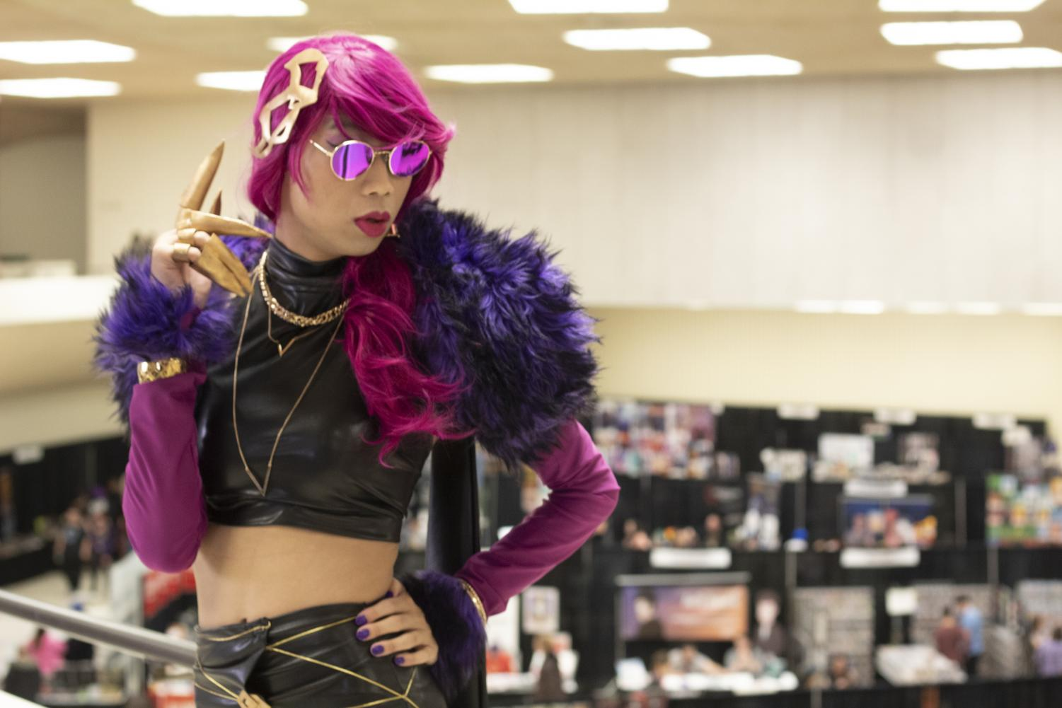 Anthony Vu, a junior engineering major, poses for a photo during Saturday's Air Capital Comic Con. Vu won Best of Show in the convention's contest for his portrayal of Evelynn from PC game
