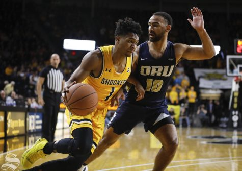 Wichita State freshman Tyson Etienne drives past Oral Roberts guard Sam Kearns at Charles Koch Arena on Saturday, Nov. 23, 2019.