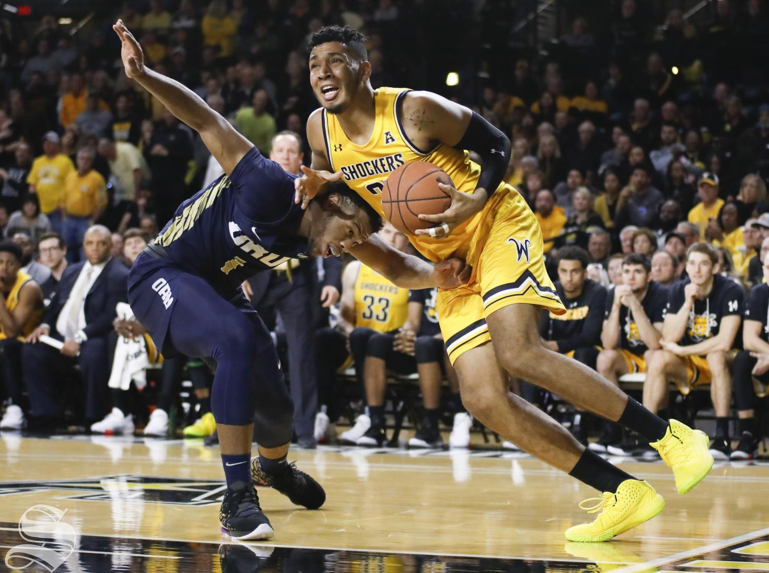Wichita State senior Jaime Echenique is fouled by Oral Roberts redshirt sophomore Elijah Lufile in the second half at Charles Koch Arena Saturday, Nov. 23, 2019.