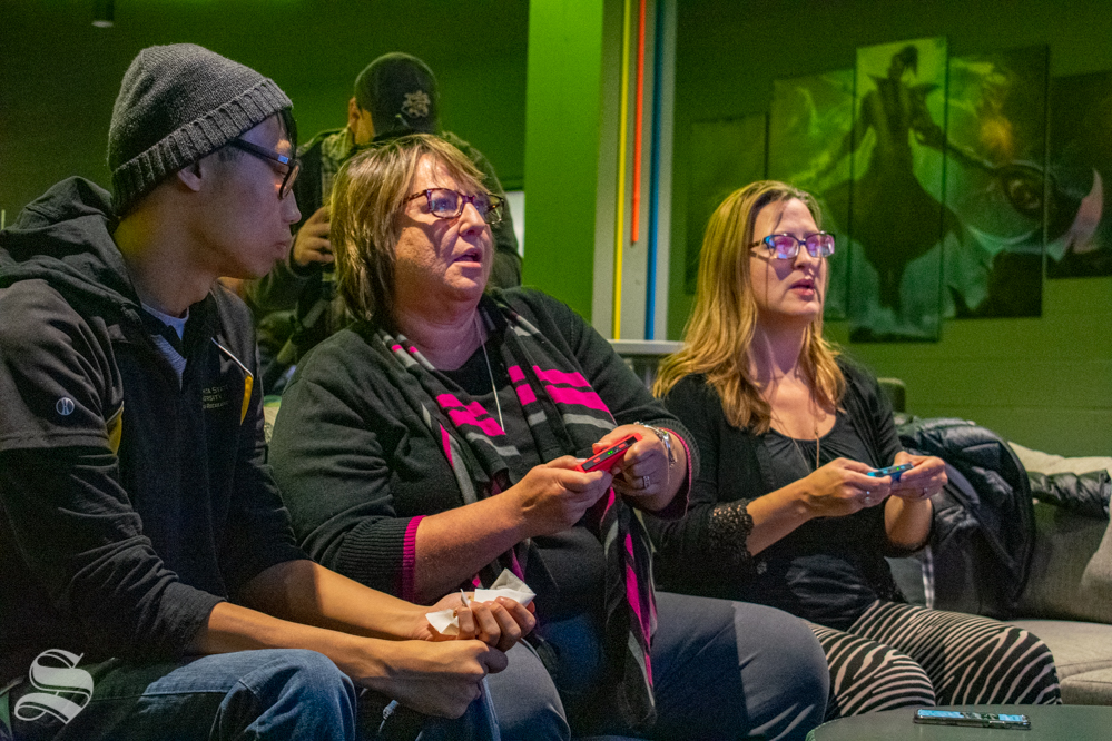 Anthony Vu watches while Teri Hall and Jessica Provines play a game on a Nintendo Switch during the opening of the WSU esports hub on Tuesday, Nov. 5 in the Heskett Center.