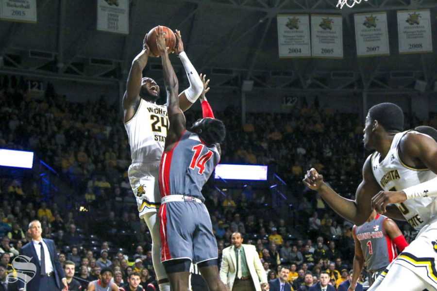 Wichita State sophomore Morris Udeze goes up for a contested shot during the game against Gardner-Webb on Nov. 19 inside Charles Koch Arena.
