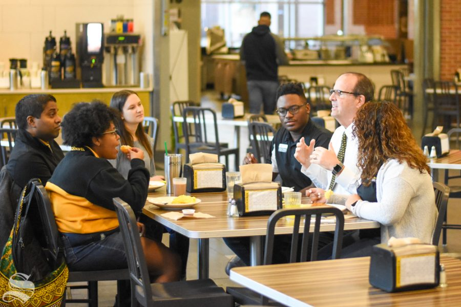 Wichita State's new president Jay Golden eats breakfast on Tuesday at Shocker Hall with community stakeholders, including a group of Diversity Interns and Bobby Gandu, assistant vice president and director of undergraduate admissions. Golden was named the 14th president of WSU in October.